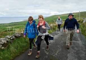 Anne O Dwyer and Claire Moylan followed by Michael Cummins during the Burren Ramble in aid of the RNLI at Fanore. Photograph by John Kelly
