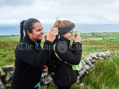 Noa Garcia and Franzsiska Gerwe taking pictures during the Burren Ramble in aid of the RNLI at Fanore. Photograph by John Kelly