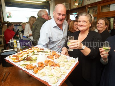Allen Flynn of The Old Ground with Margaret O Brien, Programme Director, at the launch of Ginis, a new limited edition Gin, at the official opening of the Clare Food And Drink Fleadh in Fawl's Bar, Ennis. Photograph by John Kelly