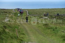 A trio of walkers, led by Doolin Coast Guard, Tom Doherty, take a short cut during the Burren Ramble on Sunday.