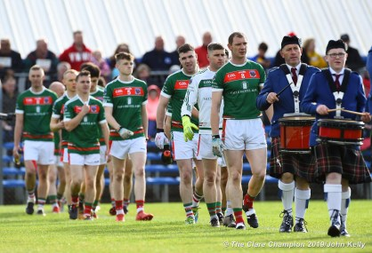 Keith King (C) of Kilmurry Ibrickane leads out his team behind the band before their senior football county final at Cusack Park. Photograph by John Kelly.