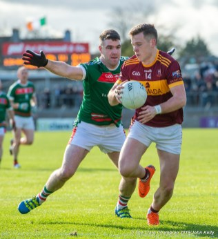 Darren Hickey of Kilmurry Ibrickane in action against Darragh Mc Donagh of Miltown during their senior football county final at Cusack Park. Photograph by John Kelly.