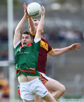 Martin Mc Mahon of Kilmurry Ibrickane in action against Gearoid Curtin of Miltown during their senior football county final at Cusack Park. Photograph by John Kelly.
