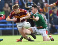 Cormac Murray of Miltown in action against Mark Killeen of Kilmurry Ibrickane during their senior football county final at Cusack Park. Photograph by John Kelly.