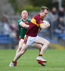 Michael Hogan of Kilmurry Ibrickane in action against Gearoid Curtin of Miltown during their senior football county final at Cusack Park. Photograph by John Kelly.