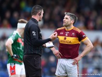 Gordon Kelly (C) of Miltown is spoken to by referee Chris Maguire during their senior football county final at Cusack Park. Photograph by John Kelly.