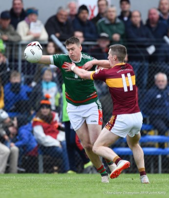 Daryn Callinan of Kilmurry Ibrickane in action against Eoin Cleary of Miltown during their senior football county final at Cusack Park. Photograph by John Kelly.