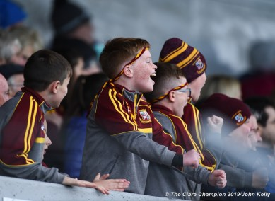 Young Miltown fans celebrate as their team goes up by a point during their senior football county final at Cusack Park. Photograph by John Kelly.