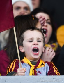 A young Miltown fan cheers on his team near the end of their senior football county final at Cusack Park. Photograph by John Kelly.
