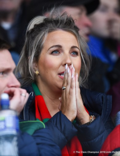 A Kilmurry Ibrockane fan looks on in anticipation as Ian Mc Inerney takes a free to equalise the game late on during their senior football county final at Cusack Park. Photograph by John Kelly.