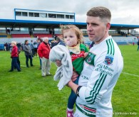 Ian Mc Inerney of Kilmurry Ibrickane, who got the equalising point from a late free with his daughter Erin following their senior football county final at Cusack Park. Photograph by John Kelly.