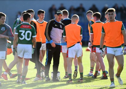 Aiden Moloney, Kilmurry Ibrickane manager with his charges before their senior football county final replay at Cusack Park. Photograph by John Kelly.
