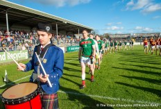 Keith King (C) of Kilmurry Ibrickane, leads the team behind the pipe band before their senior football county final replay at Cusack Park. Photograph by John Kelly.