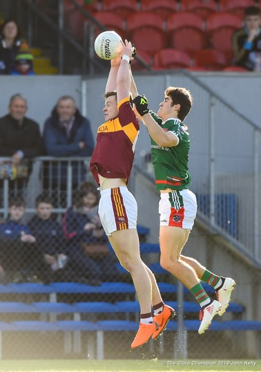 Kieran Malone of Miltown in action against Aidan Mc Carthy of Kilmurry Ibrickane during their senior football county final replay at Cusack Park. Photograph by John Kelly.