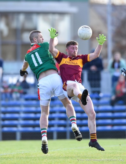 Enda Couglan of Kilmurry Ibrickane in action against Eoin O Brien of Miltown during their senior football county final replay at Cusack Park. Photograph by John Kelly.