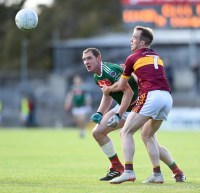 Keith King (C) of Kilmurry Ibrickane in action against Gearoid Curtin of Miltown during their senior football county final replay at Cusack Park. Photograph by John Kelly.