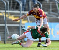 Keelan Sexton of Kilmurry Ibrickane in action against Seanie Malone of Miltown during their senior football county final replay at Cusack Park. Photograph by John Kelly.