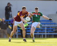Conor Cleary of Miltown in action against Darren Hickey of Kilmurry Ibrickane during their senior football county final replay at Cusack Park. Photograph by John Kelly.
