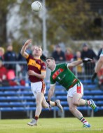 Gearoid Curtin of Miltown in action against Darren Hickey of Kilmurry Ibrickane during their senior football county final replay at Cusack Park. Photograph by John Kelly.