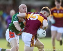 Michael Hogan of Kilmurry Ibrickane in action against Cormac Murray of Miltown during their senior football county final replay at Cusack Park. Photograph by John Kelly.