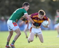 Mark Killeen of Kilmurry Ibrickane in action against Cormac Murray of Miltown during their senior football county final replay at Cusack Park. Photograph by John Kelly.
