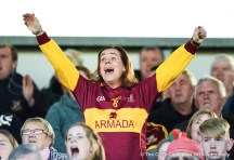 A Miltown fan celebrates a point late on during their senior football county final replay at Cusack Park. Photograph by John Kelly.