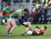 Cormac Murray of Miltown in action against Billy Power and Michael Curry (C) of Rathgormack of during their Munster Club quarter final at Miltown. Photograph by John Kelly