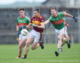 Gordon Kelly (C) of Miltown in action against Michael Curry and Conor Murray of Rathgormack of during their Munster Club quarter final at Miltown. Photograph by John Kelly