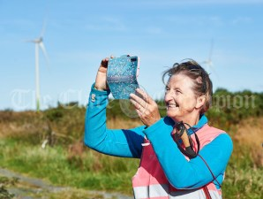 Marie Hegarty taking photos of the scenery while taking part in the Shades Of Autumn 10k walk in aid of the RNLI on bank Holiday Monday at Shragh. Photograph by John Kelly.