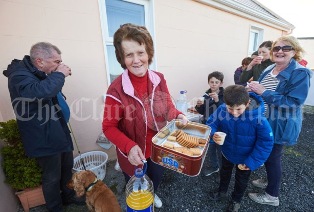 Jane Mc Mahon offering weary walkers a selection of refreshments at her home during the Shades Of Autumn 10k walk in aid of the RNLI on bank Holiday Monday at Shragh. Photograph by John Kelly.
