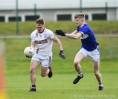 Rowan Danaher of St Breckan's in action against Patrick Clifford of Templenoe during their Munster Club Intermediate final at Mallow. Photograph by John Kelly