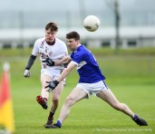 Aidan Davidson of St Breckan's in action against Michael Hallissey of Templenoe during their Munster Club Intermediate final at Mallow. Photograph by John Kelly