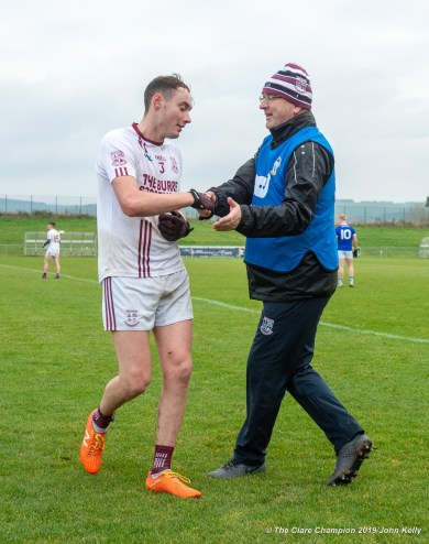 Manager of St Breckan's Donie Garrihy has a word of appreciation for player Evan Barrett as he is substituted during their Munster Club Intermediate final against Templenoe at Mallow. Photograph by John Kelly