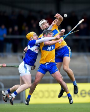 Ian Galvin and Aron Shanagher of Clare in action against Padraig Delaney of Laois during their National League game at Cusack Park. Photograph by John Kelly