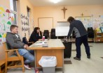 A voter casts his vote watched by Sean Hegarty, Poll Clark and Mairead Fitzpatrick, Presiding Officer during voting in the General Election 2020 at Kilfenora NS. Photograph by John Kelly.