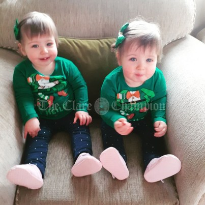 Identical twins Holly and Sophie Whelan enjoying St Patrick's Day at home in O'Callaghan's Mills