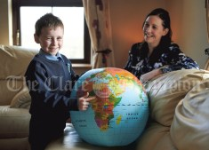 Jack Healy (aged 7) who recently raised more than €500 for Africa, pictured with his mother Karen at home in Liscannor. Photograph by John Kelly