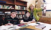 Co-ordinator Josephine Dempsey working on maths with LCA 1 students Ian McInerney and Bernie Lysaght.