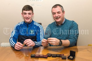 Pat Healy reminiscing with his son Darragh aboutthe Harty Cup and All Ireland Colleges medals he won in 1987 with St Flannan's. This week Darragh lines out in the St FLannan's team for their rescheduled Harty final against CBC Cork in Mallow. Photograph by Eugene McCafferty on 25/02/2020