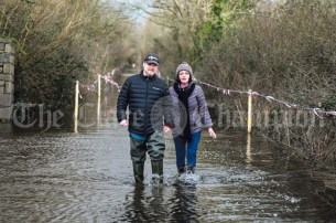 Mike and Liz Hogan try to return to their home in Springfield along the access road which is completely flooded. Temprarily housed in accommodation at the Castleoaks Hotel complex, the couple also experienced evacuation back in 2016 and a number of other times over the last 20 years. Photograph by Eugene McCafferty on 25/02/2020