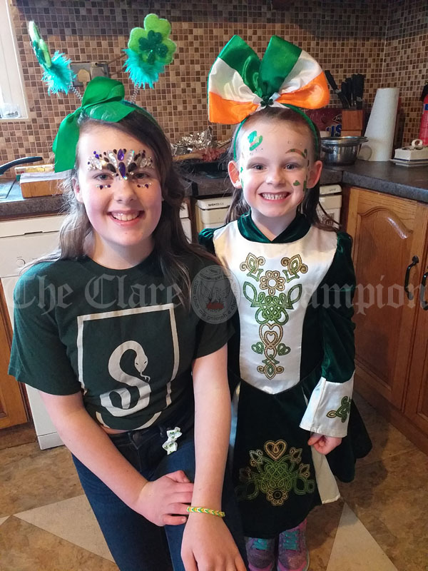 Zoe and hannah dressed up for st. Patrick's day.