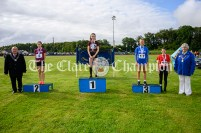 Podium places for the Girls U14 80m hurldles: 1st Evie Quinn (Tulla), 2nd Lucy Shannon (Doora Barefield), 3rd Saoirse Kent (Inch-Kilmaley-Connolly) and 4th Sarah Slattery (Quin-Clooney), with Cllr PJ Ryan, Cathaoirleach of Clare County Council, and Cecilia O'Sullivan, President of Clare Community Games. Photography by Eugene McCafferty