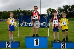 Podium finishes for (l-r) Sean Hassett (Doora-Barefield), Sean Hick (Ballynacally-Lissycasey), Conall O'Murchu (Tulla) and Darragh O'Rourke (Inagh-Kilnamona) in the Boys U8 60m track event. Photography by Eugene McCafferty
