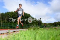Finn Duignan of Ennis-St-Johns strides to victory in the Boys 800m event. Photography by Eugene McCafferty