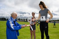 Graham Meakins, husband of the late Rose Meakins, presents Ava Rochford (Ennis-St-Johns) and Lisa Nicholas from Tulla with their U16 Girls High Jump medals. Photography by Eugene McCafferty