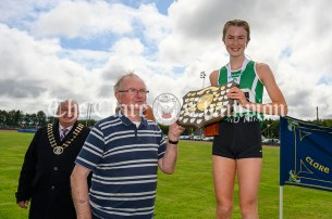 Michael Lillis presents Gemma Galvin with the shield for her success in the Girls U16 1500m event. Gemma is currently is All Ireland champion and captain of Clare Community Games. Photography by Eugene McCafferty