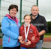 Proud parents Maria and Patrick with their medal-winning daughter Anna from Ballynacally/Lissycasey enjoying Clare Community Games athletics finals. Photography by Eugene McCafferty