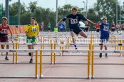 Cian O'Gorman from Cratloe powering his way to victory in the U14 Boys 80m hurdles final. Photography by Eugene McCafferty