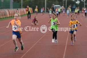 Sophia Moroney from Newmarket on Fergus running to victory in the Girls U8 60m event ahead of Doireann McDonagh (Lisdoonvarna) and Molly Considine (Ennistymon-Lahinch-Liscannor). Photography by Eugene McCafferty