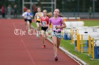 Aisling Kelly of Ennis-St-Johns finishes strongly in the final of the Girls U12 600m event ahead of Emma Haugh from Ballynacally-Lissycasey. Photography by Eugene McCafferty